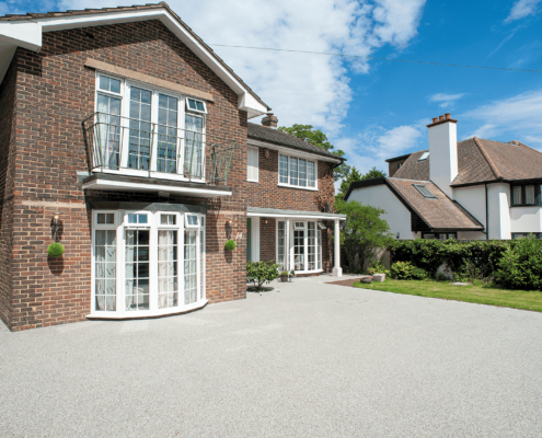 Light grey resin bonded driveway to detached property in Epsom Surrey