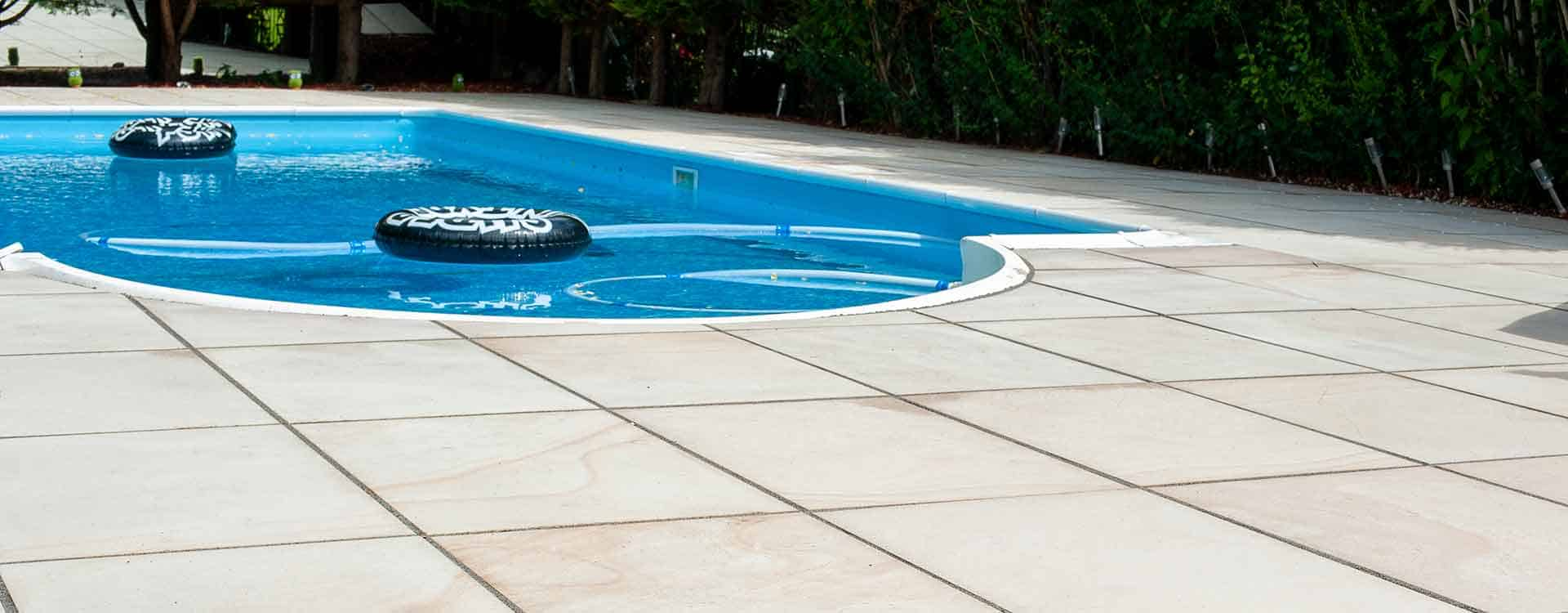 Paved area around swimming pool
