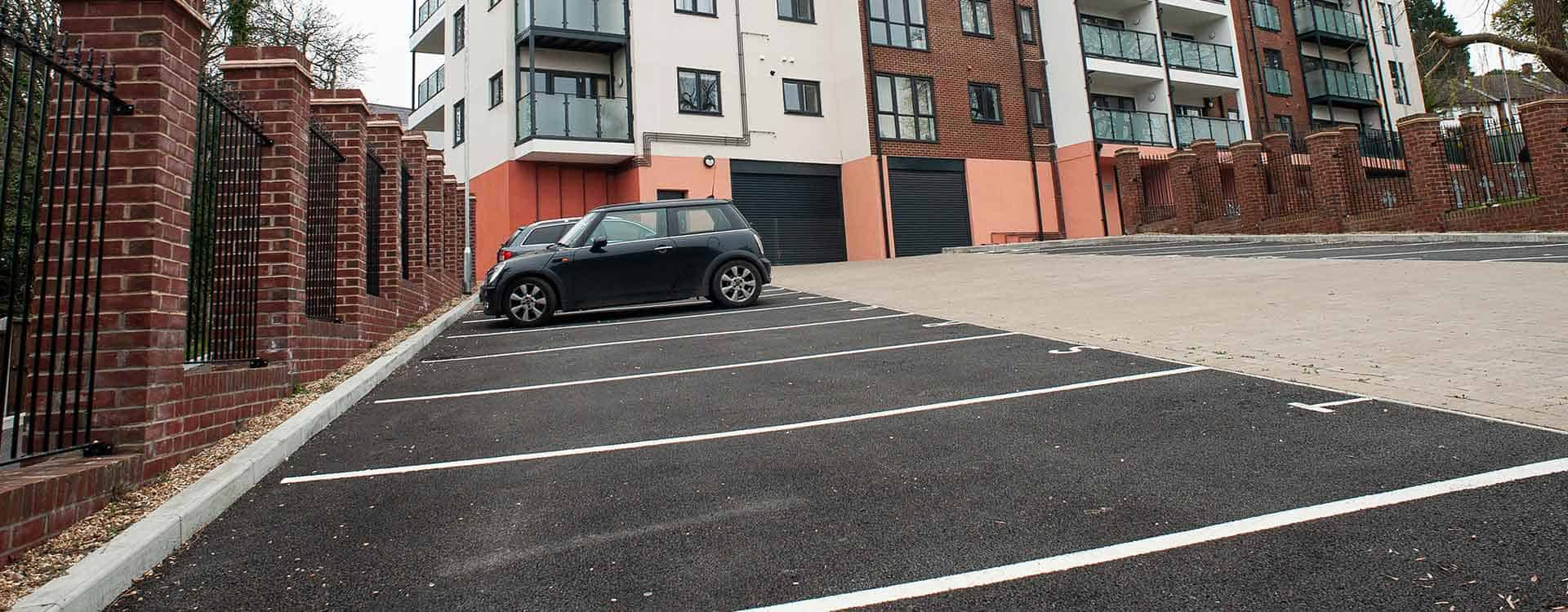 Car park with tarmced bays and block paved road