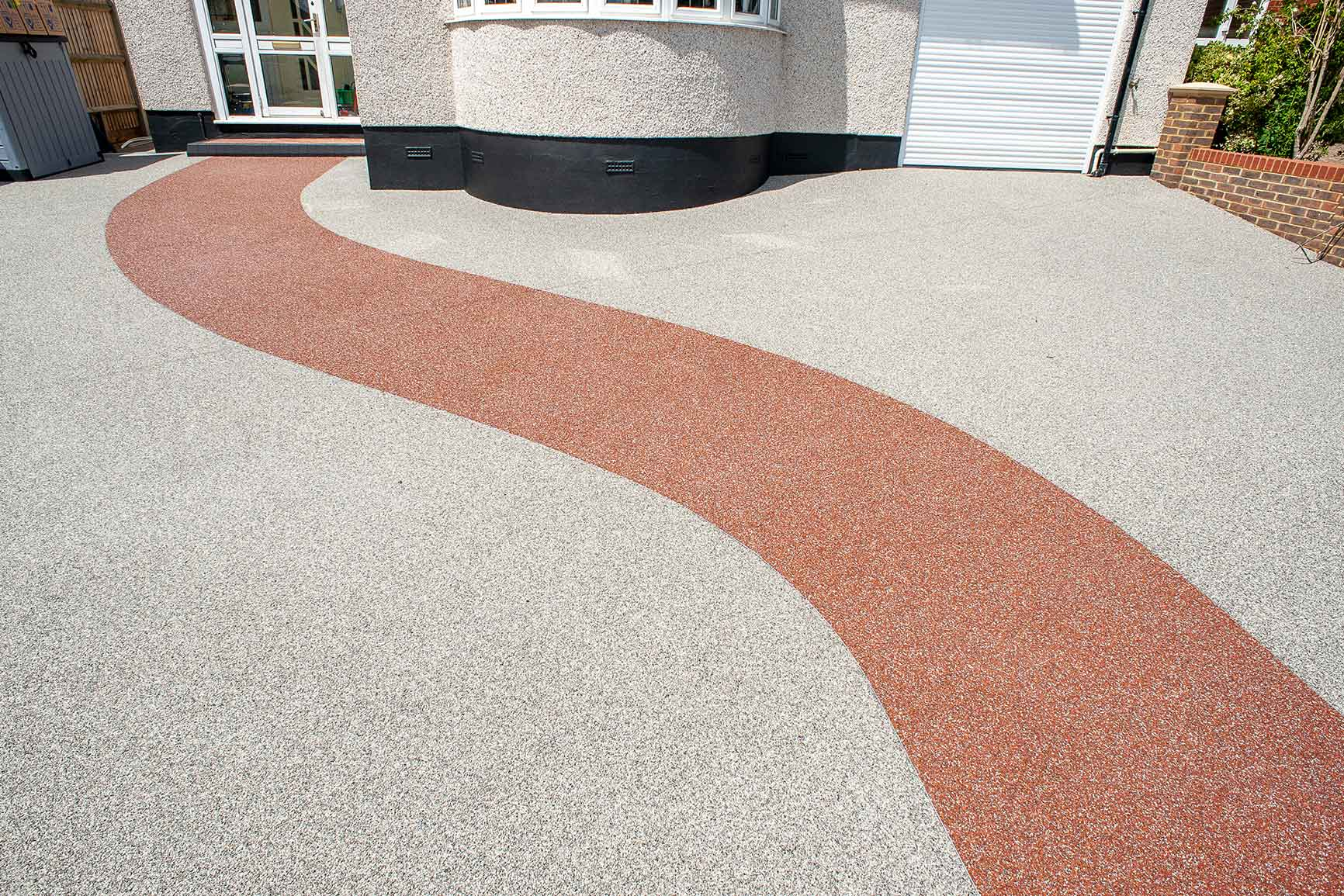 resin driveway with res resin bound pathway through it