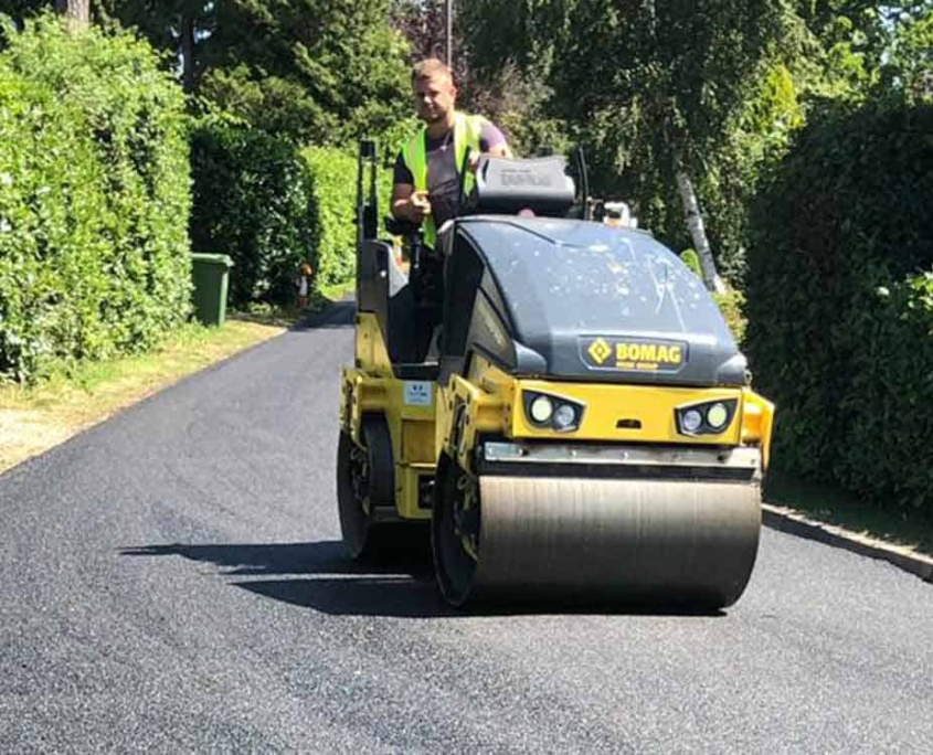 Roller working on newly tarmced private road in camberley