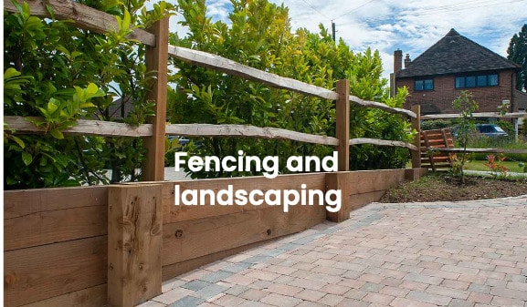 Ranch style residential fencing with block paved driveway