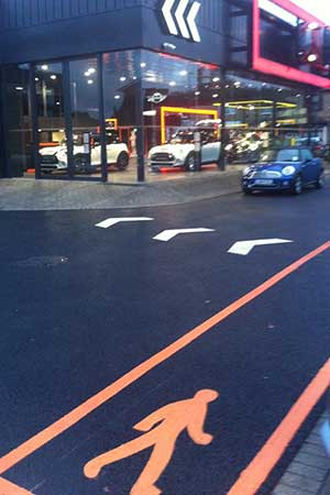 resurfacing of forecourt with specified lining colouring in bright orange