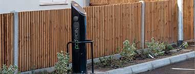 Electric car charging point in car park