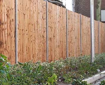Landscaped feather board fencing with newly planted groundworks