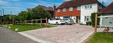 Ranch style fecncing with large block paved driveway
