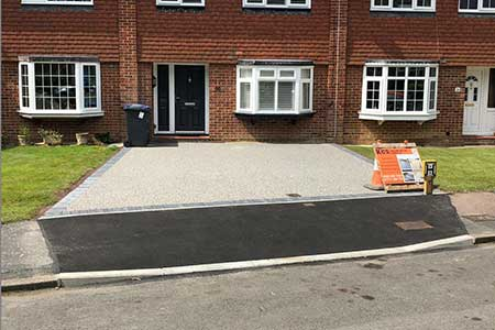 Dropped kerb with light grey resin bound driveway East Grinstead
