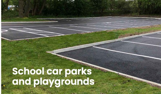 Newly laid school car park with white lining