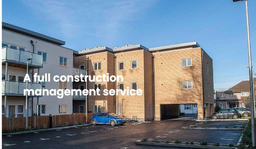 Housing association development with car park and electric car charging points