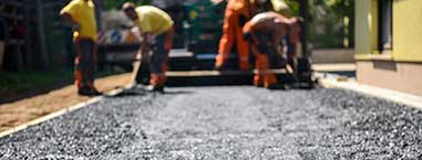 laying tarmac for private road