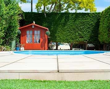 Landscaped small garden with swimming pool