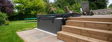 residential groundworks hot tub decking with paving