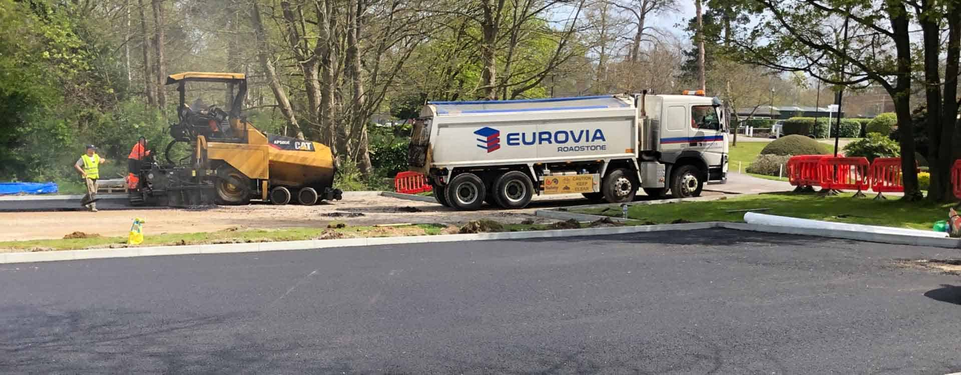 Heavy plant laying tarmac for school playground