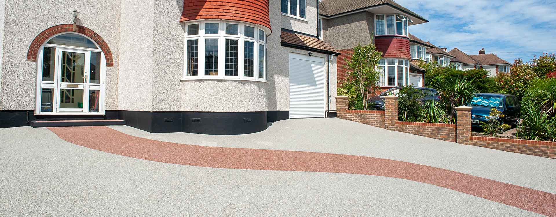 Resin bonded driveway with red curved path detail