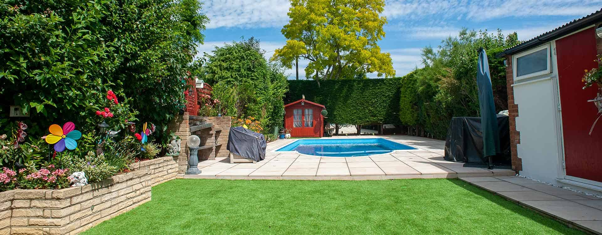 Patio for swimming pool with artificial grass